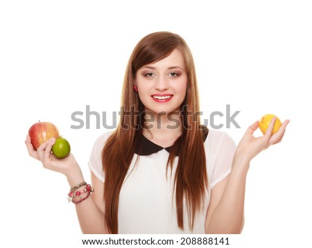 Diet and nutrition. Smiling girl holding fruits apple lemon and lime isolated on white. Happy woman recommending healthy food. - stock photo