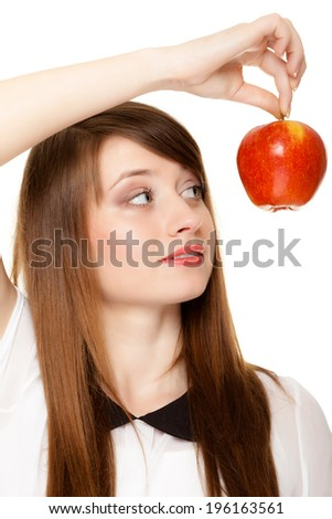 Diet and nutrition. Young woman holding apple seasonal fruit isolated on white. Girl recommending healthy lifestyle. - stock photo