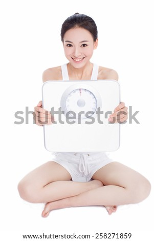 diet and sport concept - woman with scales - stock photo