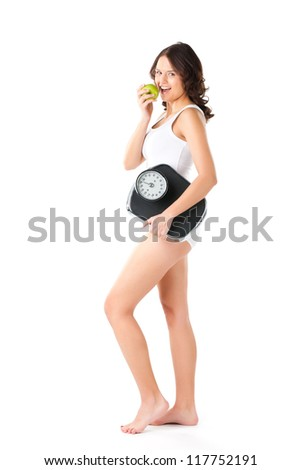Diet and weight, young woman with scale under her arm and apple - stock photo