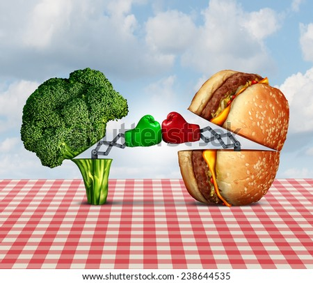 Diet battle and food fight nutrition concept as a fresh healthy broccoli fighting an unhealthy cheese burger with boxing gloves punching each other. - stock photo