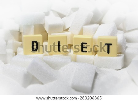 diet block letters word on pile of sugar cubes close up in dieting , healthy nutrition and sugar consume reduction  - stock photo