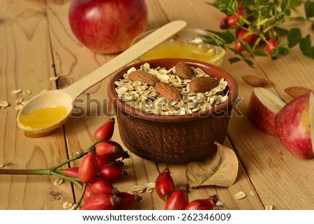 Diet breakfast - cereal, apples, honey on wooden background - stock photo