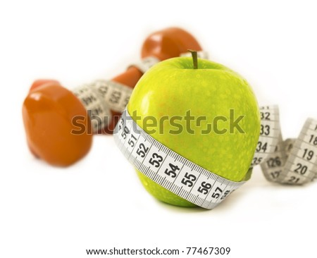 diet concept, apple and dumbbells with measuring tape