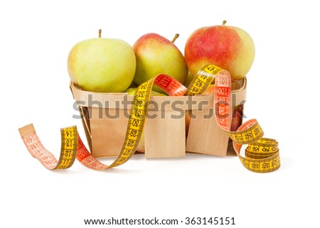 diet concept, apples in basket with measuring tape isolated on white background  - stock photo