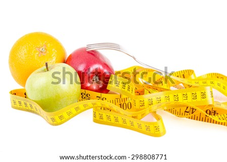 Diet concept. Fruits with measuring tape - stock photo