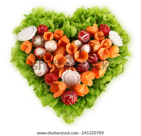 diet concept heart shape lettuce carrots radishes  - stock photo