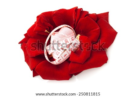 Diet concept. measuring tape isolated in petals of rose flower isolated on white background. Dieting