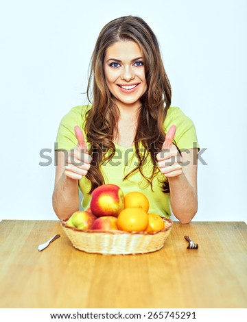 diet concept portrait of young woman showing thumbs . isolated