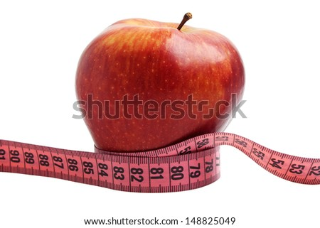Diet concept - red apple and measuring tape - stock photo