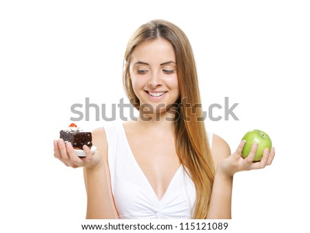 diet concept:  Woman choosing between fruits and cakes - stock photo