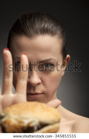 Diet concept: woman say no a fatty foods - stock photo
