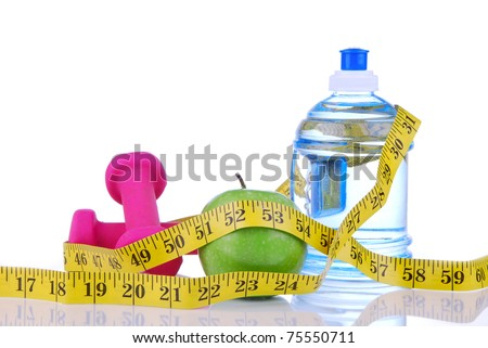 Diet diabetes weight loss concept with tape measure organic green apple, pink dumbbels and natural bottle of sparkling water on a white background. Focus on water - stock photo