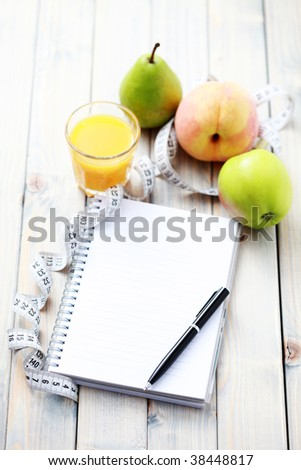 diet diary and fresh fruits - diet and breakfast - stock photo