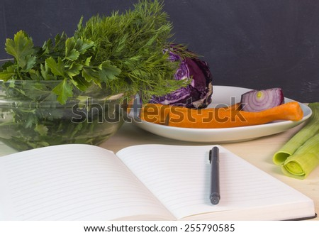 Diet diary - keep a record of what you eat in a journal - stock photo