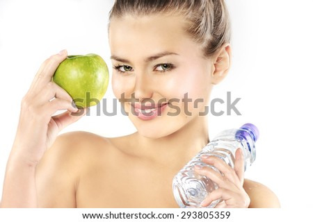 Diet. Dieting concept. Healthy Food. Beautiful Young Woman biting green apple and drinking water. Fit.  Holding Apple Smiling at Camera. Beautiful healthy woman. Weight loss.  - stock photo