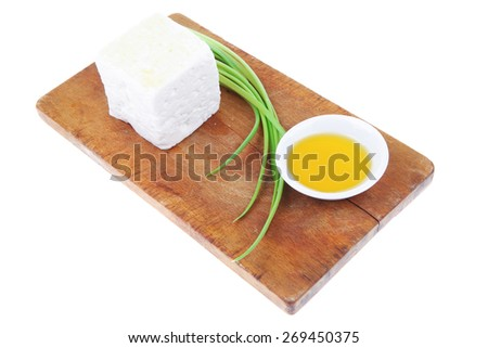 diet food : greek feta white cheese served on wooden plate isolated over white background - stock photo