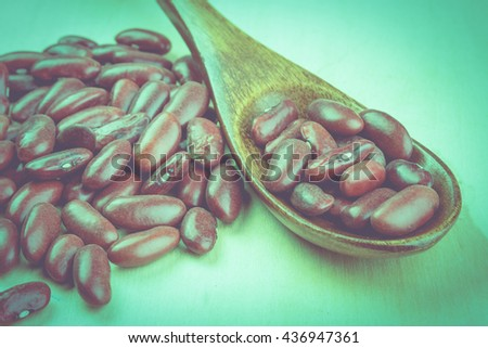 Diet food with red beans, red beans on wooden table, retro tone, warm tone   - stock photo