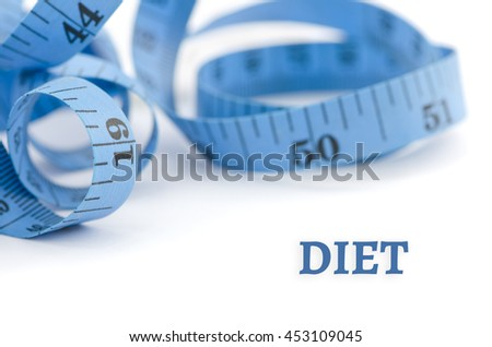 Diet, health concept, close up & selective focus of blue measuring tape, isolated on white background