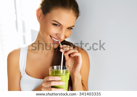 Diet. Healthy Eating Woman Drinking Fresh Raw Green Detox Vegetable Juice. Healthy Lifestyle, Vegetarian Food And Meal. Drink Smoothie. Nutrition Concept. - stock photo