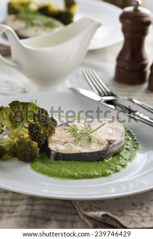 Diet healthy food. Steamed mackerel with herb sauce and broccoli - stock photo