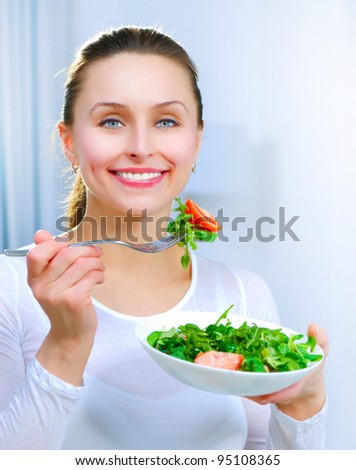 Diet. Healthy Young Woman Eating Vegetable Salad - stock photo