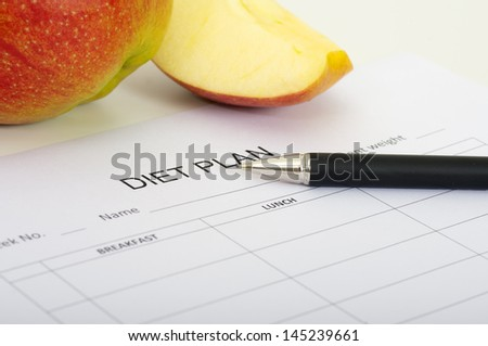 diet plan, apples and pen - stock photo