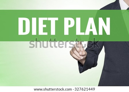 Diet Plan word on green virtual screen touching by business woman - stock photo