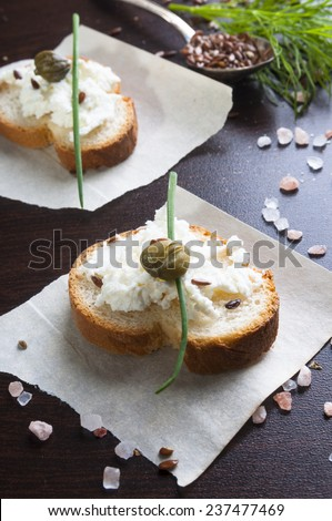 Diet sandwiches with cheese curds and capers, flax seeds, dill - stock photo