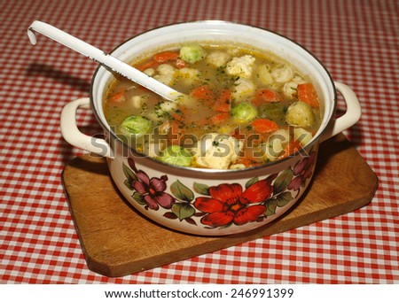 Diet soup with fresh vegetables.  	Homemade vegetable soup with brussels sprouts