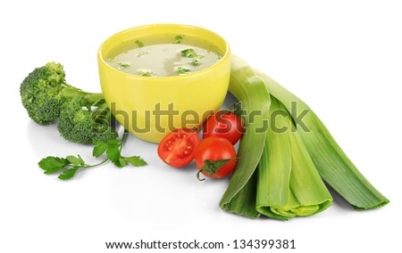 Diet soup with vegetables in cup isolated on white - stock photo