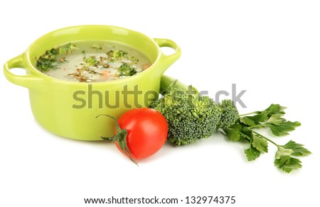 Diet soup with vegetables in pan isolated on white - stock photo
