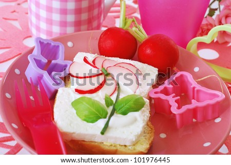 diet spring sandwich with cottage cheese,cream and radish flower  as breakfast for child - stock photo