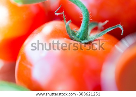 diet, vegetable food, harvest and objects concept - close up of ripe juicy red tomatoes - stock photo