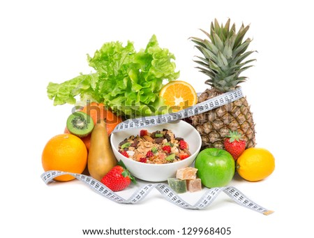 Diet weight loss breakfast concept with tape measure organic green apple, cereal bowl, orange juice, pineapple, muesli cereal bowl, pear, kiwi, lemon, rahat delight, strawberries on a white background - stock photo