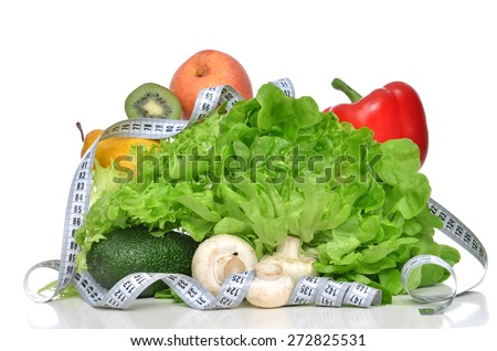 Diet weight loss breakfast concept with tape measure organic green apple salad bananas kiwi avocado pear mashrooms red pepper pear on a white background - stock photo