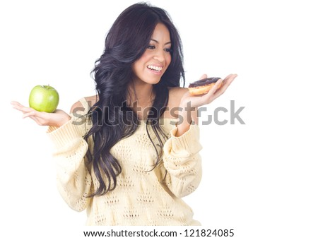 Diet woman holding apple and donut on white background - stock photo