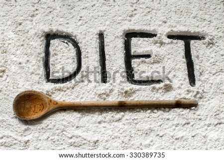 Diet Word Written on Baking Sheet Covered with White Flour