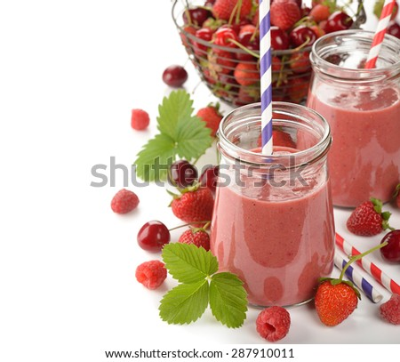 Dietary berry smoothies on a white background - stock photo