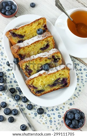 Dietary cake with blueberries fresh summer berries top view on white table - stock photo