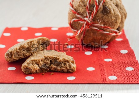Dietary cookies with dried fruits on red napkin and tied with a rope.