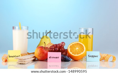 Dietary foods for breakfast, dinner and supper on blue background