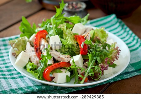 Dietary salad with chicken, cheese feta arugula and sweet red pepper - stock photo