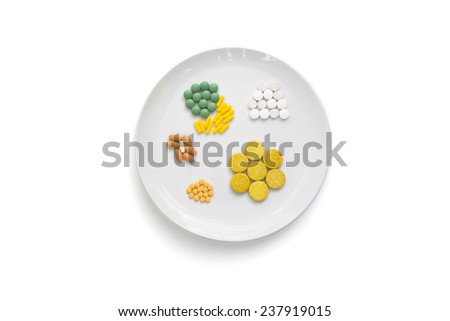 DIETARY SUPPLEMENT 2 - A dish with various drugs on it, that resembles a regular dish with food on. - stock photo