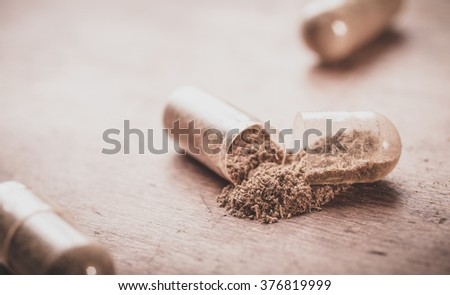 Dietary supplement of herbs. - stock photo