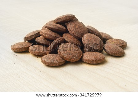Dietary supplements- food additive, plant-based tabletson a wooden background - stock photo