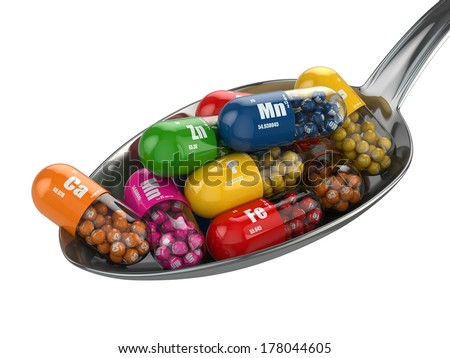 Dietary supplements. Variety pills. Vitamin capsules on the spoon. 3d - stock photo