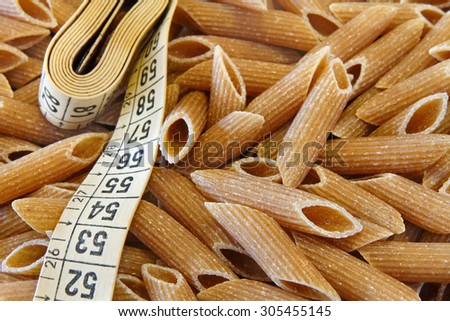 Dietetic whole wheat italian pasta pens with tape meter