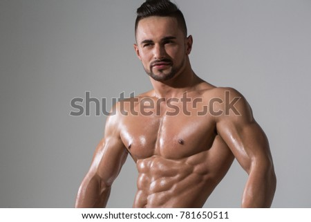 Dieting and fitness. Man with muscular wet body and torso. Sport and workout. Coach sportsman with bare chest. Athletic bodybuilder man on grey background, copy space