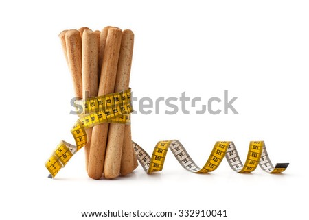 Dieting Concept , Breadstick with measurement , isolated on white - stock photo